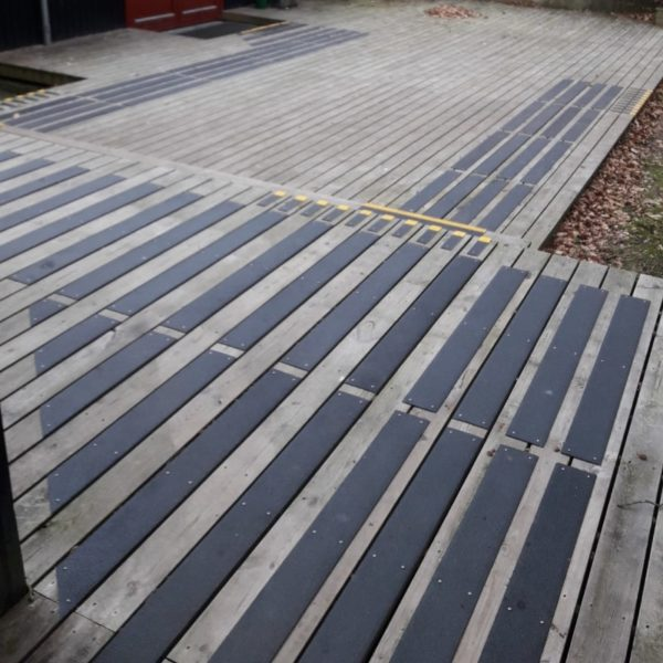 Deck strips in black mounted on wood. 2