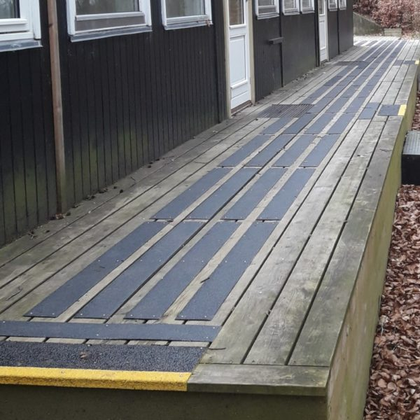 Deck strips in black mounted on wood. 3