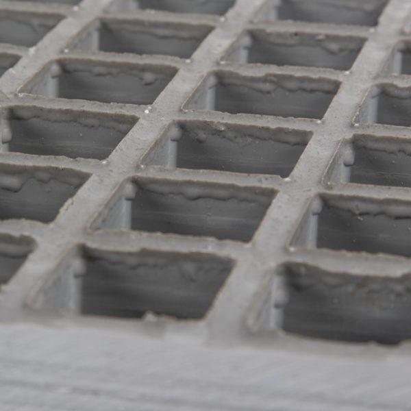 Concave glassfibre grating in grey.