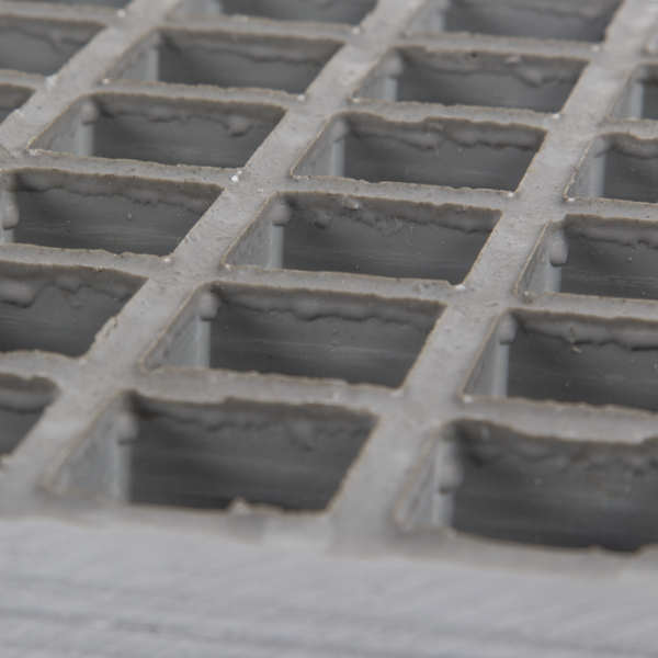 Concave glassfibre grating in grey.