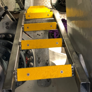 Anti-slip ladder rung covers channel mounted on steel rungs.