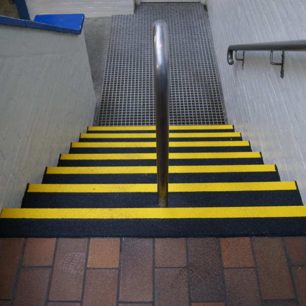 Step covers in black and yellow on tiles.
