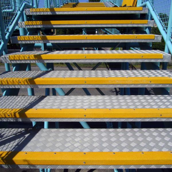 Anti-slip step nosing mounted on steel gratings.