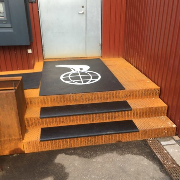 Walkway cover with company logo in black at cinema.