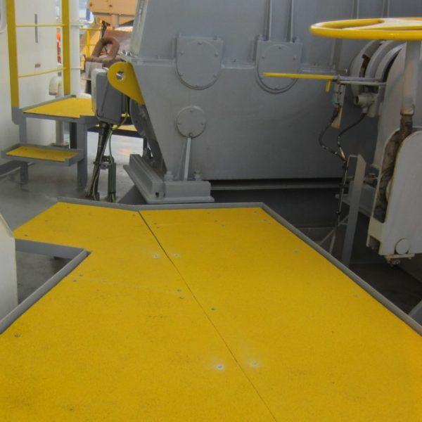 Anti-Slip walkway covers in yellow on work platform.